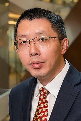 Guoqiang Mao
