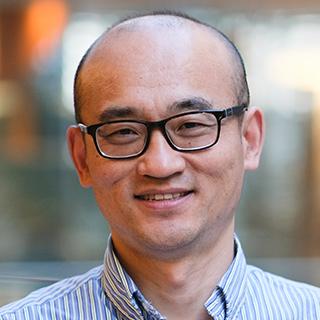 Zhenguo Huang